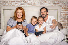 Family watching interesting program Stock Photography
