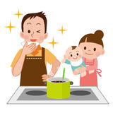 Family watching the men to cook Royalty Free Stock Images