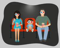 Family watching a movie in the cinema Stock Photo