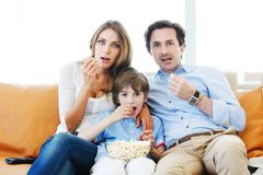 Family watching movie Stock Images