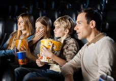 Family Watching Movie In Theater Royalty Free Stock Image