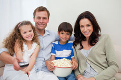 Family watching a movie together Stock Photography