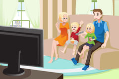 Family watching movies at home Stock Photography