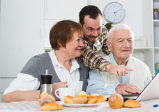 Family watching news in Inet Stock Image