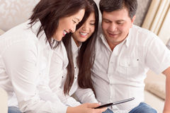 Family watching photos on tablet Stock Photos