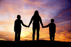 Family watching sunset. Royalty Free Stock Photo