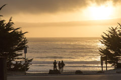 Family watching the sunset in Carmel, California Royalty Free Stock Image