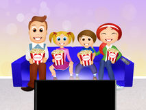 Family watching television at home Stock Photo