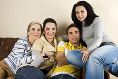 Family watching tv royalty free stock images