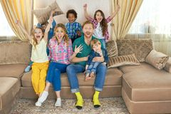 Family watching tv and celebrating. Cheerful people in the room Royalty Free Stock Photo