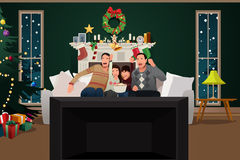 Family Watching TV During Christmas Season Stock Image