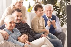 Family watching TV. Happy family watching TV together after dinner royalty free stock image
