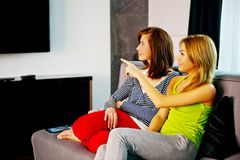 Family watching TV. Family watching TV, mother and doughter at free time Royalty Free Stock Image
