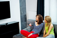 Family watching TV. Royalty Free Stock Images