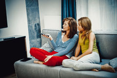 Family watching TV. Family watching TV, mother and doughter at free time Royalty Free Stock Photos