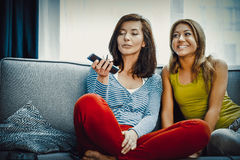 Family watching TV. Family watching TV, mother and doughter at free time Royalty Free Stock Images