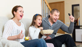 Family watching TV show Stock Photography