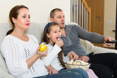 Family watching TV show Royalty Free Stock Photo