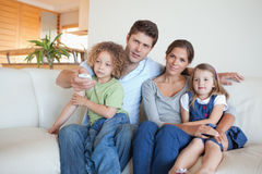 Family watching TV together Royalty Free Stock Image