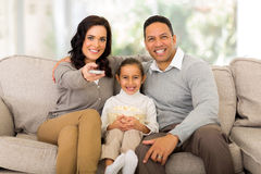 Family watching tv. Young family watching tv in the living room at home Royalty Free Stock Photos