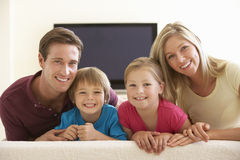 Family Watching Widescreen TV At Home Royalty Free Stock Photos