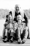 Family on the water. Happy family portrait on a sunny day in the forest royalty free stock photography