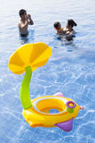 Family in water pool with children toy playing with happiness royalty free stock photos