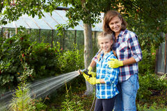 Family watered the plants in the garden Royalty Free Stock Photo