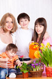 Family watering flowers Stock Images
