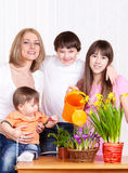 Family watering flowers Stock Photo