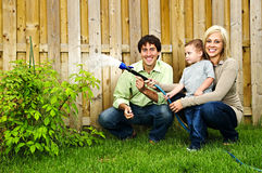 Family watering plant Royalty Free Stock Photos