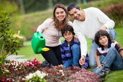 Family watering the plants Stock Image