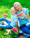Family with watermelon Stock Image