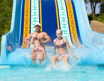 Family at waterslide royalty free stock photos