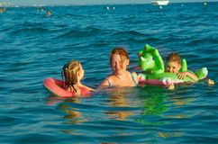 Family in the waves Stock Photos