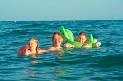 Family in the waves Royalty Free Stock Photography