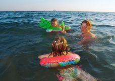 Family in the waves Stock Images