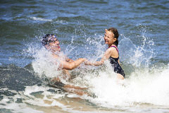 Family in waves Stock Images