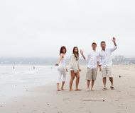 Family waving on the Beach Royalty Free Stock Images