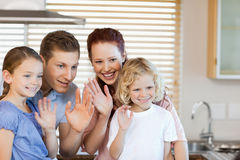 Family waving with their hands Royalty Free Stock Photo
