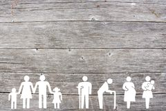 Family and Weak social categories welfare concept on wooden background. Social welfare concept on wooden background with family, old man, disabled, pregnant and royalty free stock photos