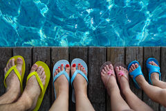 Family Wearing Brightly Colored Flip-flops Stock Photography