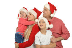 Family wearing Christmas holiday caps Royalty Free Stock Photo