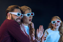 Family wearing 3d glasses watching movie together Stock Photos