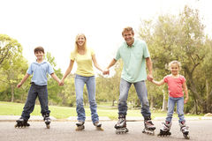 Family Wearing In Line Skates In Park Stock Photography