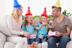 Family wearing party hat and celebrating twins birthday Royalty Free Stock Images
