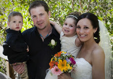 Family on wedding day. Happy young family on wedding day outdoors royalty free stock photos