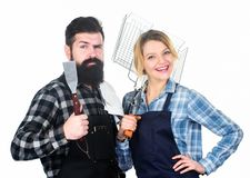 Family weekend. Picnic barbecue. food cooking recipe. Couple in love hold kitchen utensils. Man bearded hipster and girl stock image