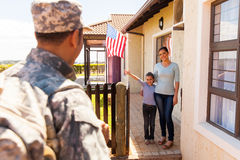 Family welcoming military fathe. Excited young american family welcoming military father returning home stock images