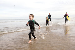 Family in Wetsuits Stock Image